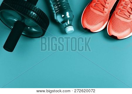Living Coral Sneakers On Blue Background. Fitness Background. Color Of The Year 2019. Main Trend Con