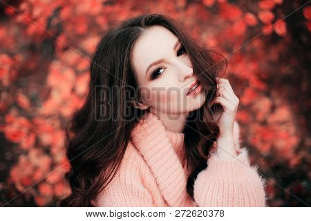 Young Sexy Thoughtful Woman With Long Hair In Fluffy Sweater, In Living Coral Forest. Color Of The Y