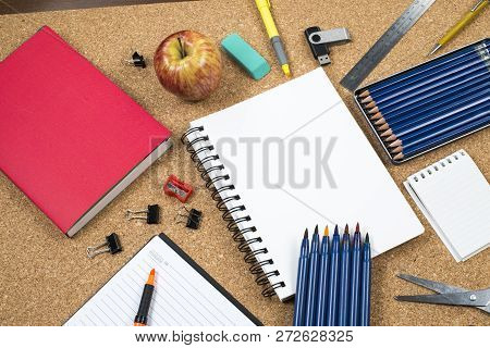 School Elements On Cork Background With Space For Text Symbolizing Back To School.