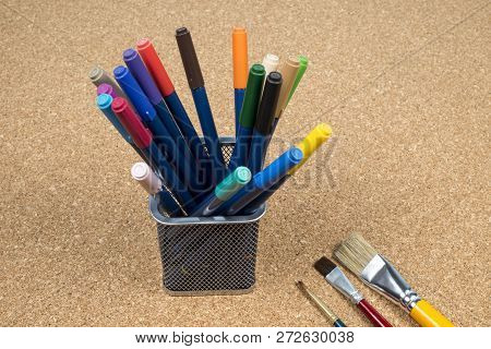 Basket With Makers Pens In A Cork Background