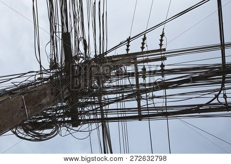 Messy Wires Attached To The Electric Pole, The Chaos Of Cables And Wires On An Electric Pole In Bang