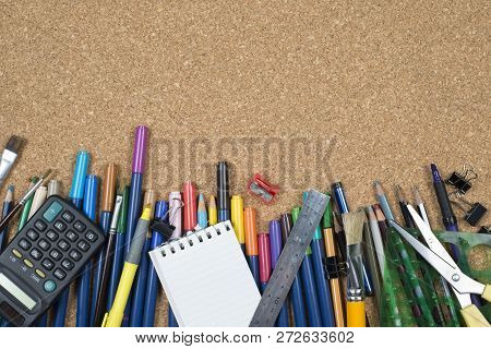 Various Stationery, Arranged On The Underside Of A Cork