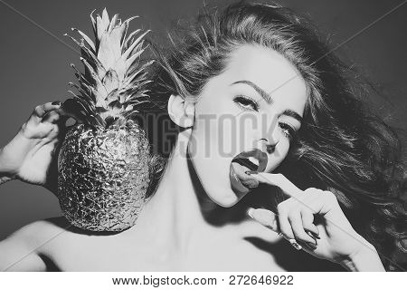 Sexy Woman With Finger In Sensual Mouth. Girl With Golden Pineapple Or Ananas. Beauty, Makeup, Look,