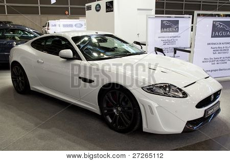 VALENCIA, SPAIN - DECEMBER 5: A 2011 White Jaguar XKR-S Coupe at the 20011 Valencia Car Show on December 5, 2011 in Valencia, Spain.