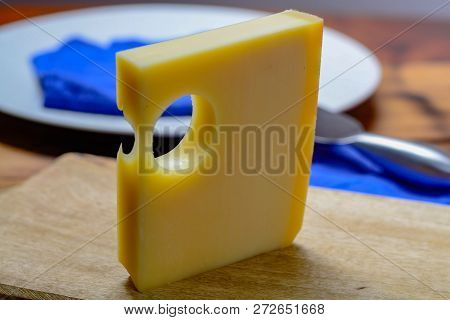 Swiss Emmental Or Emmentaler Medium-hard Cheese With Round Holes Made From Cow Milk In Canton Bern.