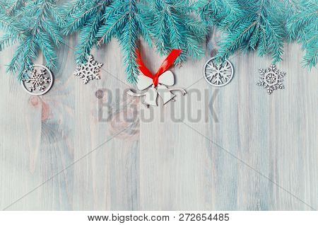 New Year and Christmas background. Christmas toys, blue fir tree on the wooden background. New Year and Christmas still life with free space for Christmas text