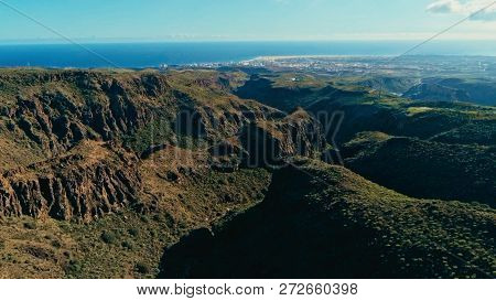 Aerial Drone Image Of Beautiful Stunning Landscape Cliffs And Valleys And Maspalomas And Playa Ingle