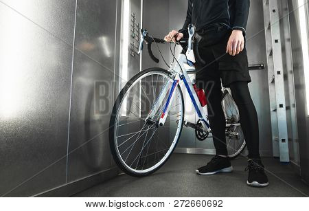 Close-up Photo Of Cyclist's Foot And Highway Bike In The Elevator. Cyclist Lives In A High-rise Buil