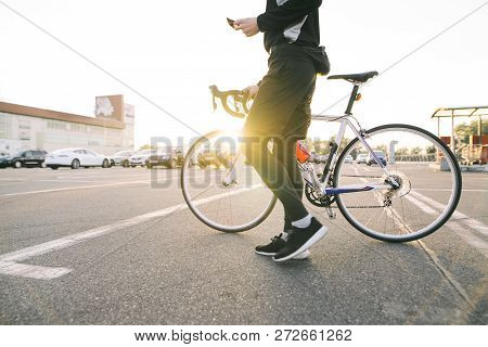 Portrait Of A Male Rider With A Bicycle On The Background Of The Sunset . Man Cyclist Rides A Bike I