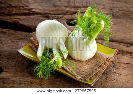 Fresh Florence Fennel Bulbs Or Fennel Bulb On Wooden Background. Healthy And Benefits Of Florence Fe