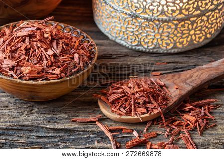 Red Sandalwood Chips On A Wooden Spoon