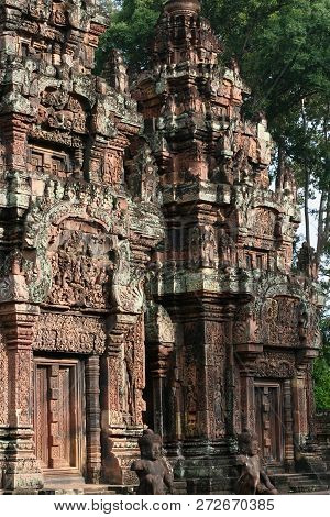 Detailed Carvings Glowing In The Afternoon Sun On The Front Facade Of A Temple In Asia