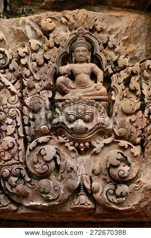Funny Little Man Sitting On A Dragon Carving In Asia Above A Doorway