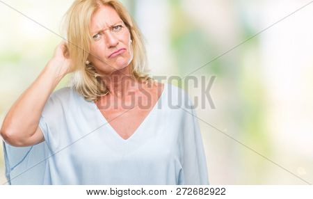 Middle age blonde business woman over isolated background confuse and wonder about question. Uncertain with doubt, thinking with hand on head. Pensive concept.