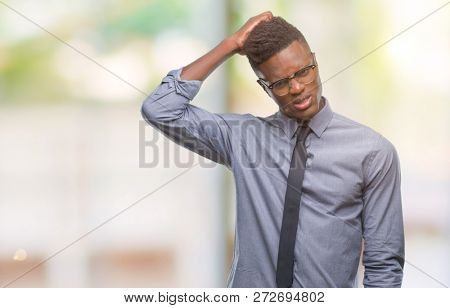 Young african american business man over isolated background confuse and wonder about question. Uncertain with doubt, thinking with hand on head. Pensive concept.