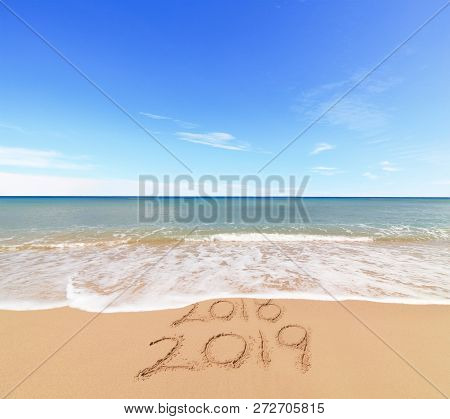 New Year 2019 Coming Concept - The Wave Is Covering Digits 2018
