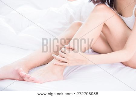 Woman Scratching Her Leg Because Of Dry Skin Or Allergies