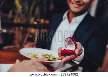 Close Up Handsome Man Proposing To Girlfriend. Romantic Couple In Love Dating. Cutel Man And Girl In