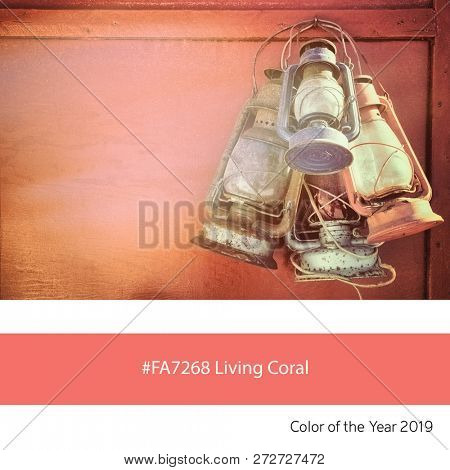 Old oil lanterns as an example of the trend colour of the year 2019, Living Coral, with corresponding colour hex.