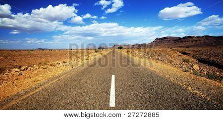 Endless road in Sahara Desert, Africa