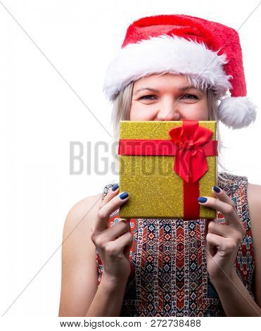 Image of joyful blonde in Santa's cap with gift on face