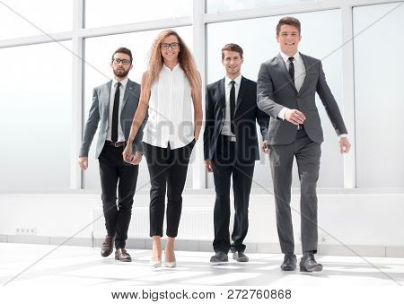 in full growth.a group of business people passing through the ha