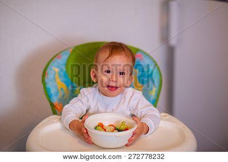 Children Eat Vegetables. Happy Kid Boy Eating Healthy Vegetables