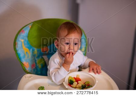 Feeding Baby - Adorable Kid Boy Eating Vegetables