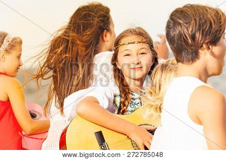 Young Musicians And Girl Soloist Playing Guitar