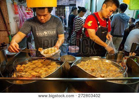 Jiufen, Taiwan - November 6: Two Men Cook Stinky Tofu At The Street Market Of Jiufen On November 6,