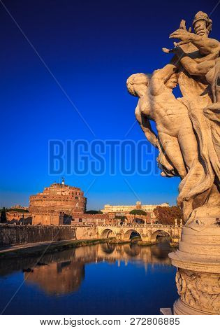 Naked Female Statue Along Vittorio Bridge In Rome, Italy On The Background The Tiber And The Mausole