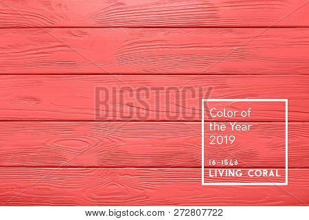 Plank Texture Of Wood Table Painted In Living Coral Color Of The Year 2019 Inscription. Trendy Paste