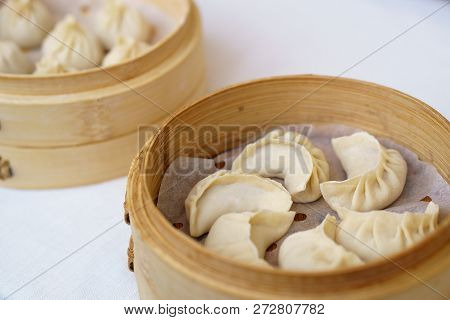 Chinese Dumplings In Bamboo Steamer. Dumplings Are Among The Mos
