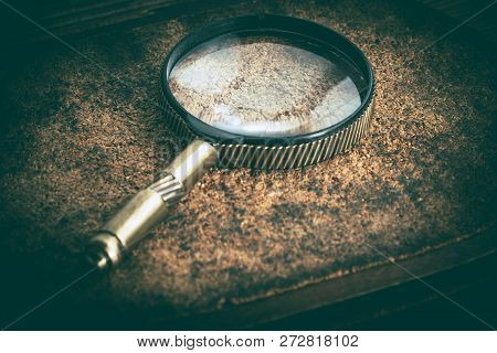 Old Magnifying Glass Or Loupe On Cork Background. Vintage Style.