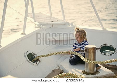 Boy Kid Playing With Rope On Yacht. Yachting And Sailing Concept. Little Child Sitting And Berthing