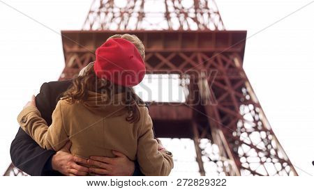 Enamored man passionately kissing beloved woman on romantic date in Paris, stock footage poster