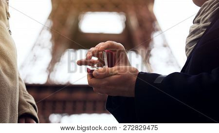 Man making marriage proposal to his beloved woman on background of Eiffel Tower, stock footage poster