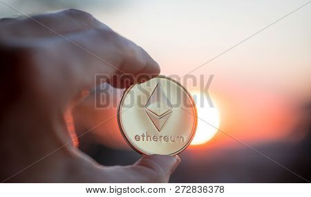 Hand With Ethereum At Sunset. Selective Focus