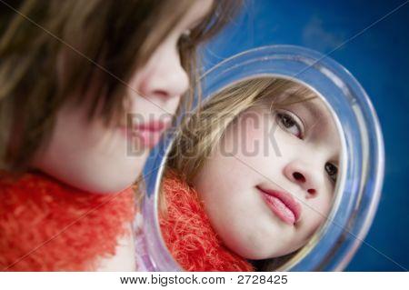Little Girl Looking A Mirror