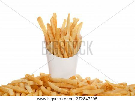 White Cup Full Of French Fries With French Fries Below On Table Isolated On White Background. French