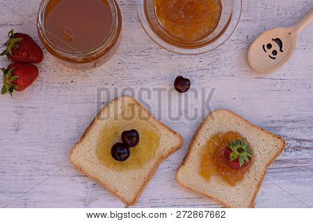 Delicious Toasts Whit Various Sweet Jams And Fruit At Light Wooden Background/ Sweet Breakfast/ Flat