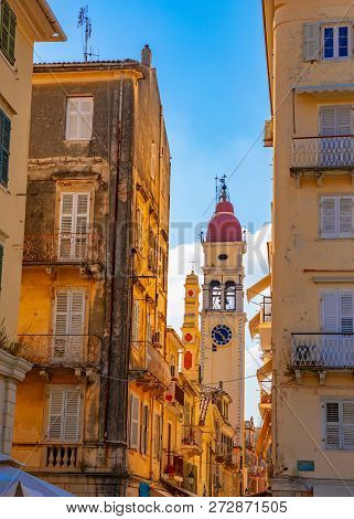 Street And The Bell Tower Of The Church Of Saint Spyridon In Corfu Town, Greece