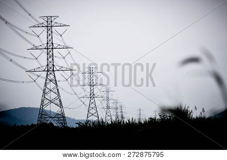 Group Silhouette Of Transmission Towers (power Tower, Electricity Pylon, Steel Lattice Tower) At Clo