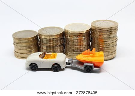 Isolated White Toy Car With Trailer Which Carrying Jetski On ItWith Coins