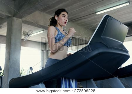 Asian Women Exercise Runner At Gym Fitness. Healthy Lifestyle And Workout Concept.