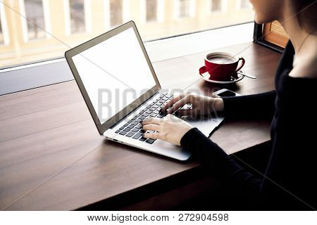 Business Woman Working In Laptop Computer, Drinking Cappuccino In Coffee Shop, Her Hands Type Text O