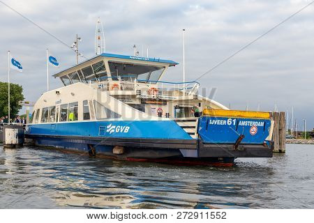 Amsterdam, The Netherlands - June 19, 2018: Passengers On Board Of A Ferry Across The Citys Ij River