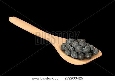 Handfull Of Blueberries On A Wooden Spoon Isolated On Black With Clipping Mask