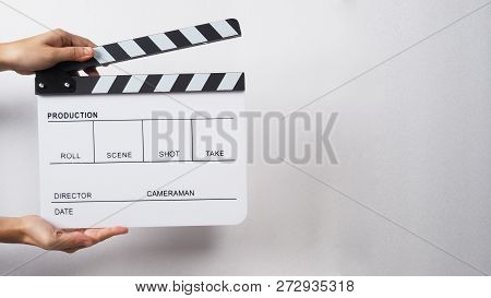 Clapper Board Or Movie Slate With Hands Use In Video Production , Movie, Cinema Industry.