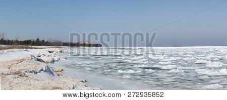 Sunny day at a frozen beach of Lake Michigan in Sleeping Bear Dunes National Lakeshore, MI poster